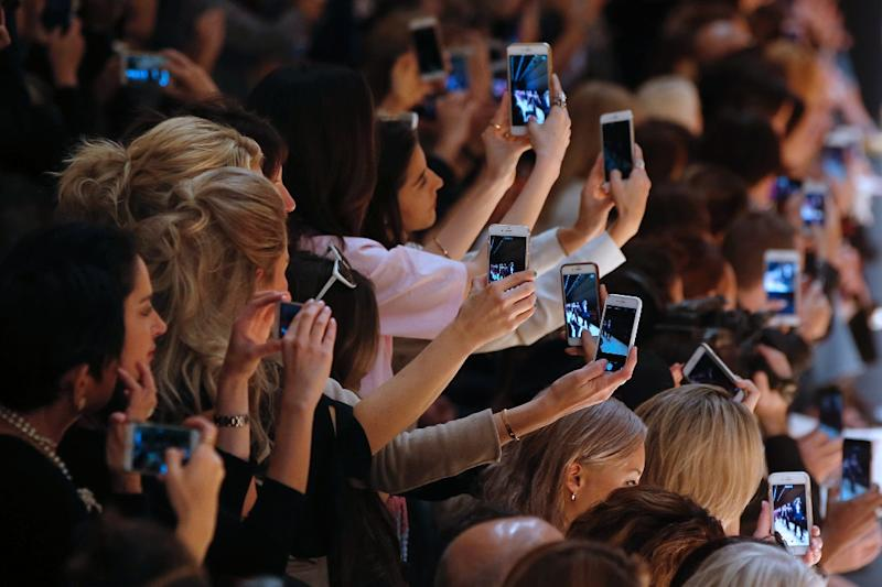 Mobile has become the new battleground for tech companies seeking to keep users within their ecosystems, where they can reach them with more products, services and advertising (AFP Photo/Patrick Kovarik)