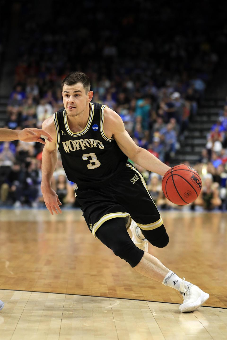 <p>Fletcher Magee #3 of the Wofford Terriers drives against the Kentucky Wildcats during the first half of the game in the second round of the 2019 NCAA Men's Basketball Tournament at Vystar Memorial Arena on March 23, 2019 in Jacksonville, Florida. (Photo by Mike Ehrmann/Getty Images) </p>