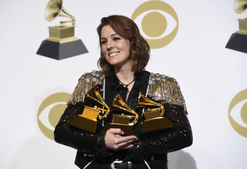 "FILE - Brandi Carlile, winner of the awards for best Americana album for ""By The Way, I Forgive You"", best American roots performance for ""The Joke"", and best American roots song for ""The Joke"" poses in the press room at the 61st annual Grammy Awards in Los Angeles on Feb. 10, 2019. Carlile's memoir, ""Broken Horses"" is coming in April. Her publisher is calling the book an ""evocative and piercingly honest"" journey through the life that has shaped her ""very raw art."" Carlile will also read the audio edition. (Photo by Chris Pizzello/Invision/AP, File)"
