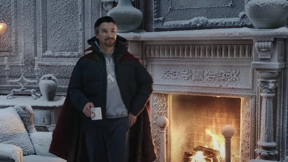 Doctor Strange in winter clothes standing in front of a fireplace with a coffee mug inside a frozen, snow-covered Sanctum Santorum