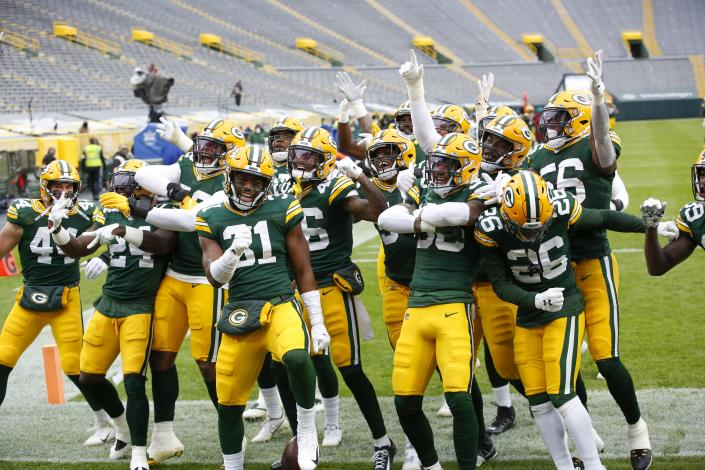 The Green Bay Packers defense celebrates after an interception and touchdown return during the first half of an NFL football game against the Jacksonville Jaguars Sunday, Nov. 15, 2020, in Green Bay, Wis. (AP Photo/Matt Ludtke)