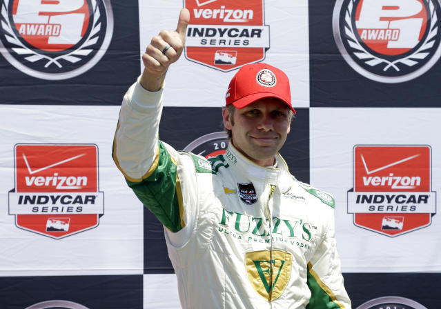 Ed Carpenter celebrates after winning the pole during qualifications for the Indianapolis 500 IndyCar auto race at the Indianapolis Motor Speedway in Indianapolis, Sunday, May 18, 2014. (AP Photo/Michael Conroy)