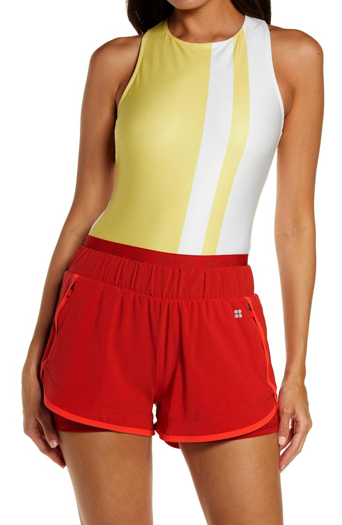 """<p><strong>SWEATY BETTY</strong></p><p>nordstrom.com</p><p><strong>$40.80</strong></p><p><a href=""""https://go.redirectingat.com?id=74968X1596630&url=https%3A%2F%2Fwww.nordstrom.com%2Fs%2Fsweaty-betty-all-day-bodysuit%2F5922139&sref=https%3A%2F%2Fwww.womenshealthmag.com%2Ffitness%2Fg22096300%2Fbest-80s-workout-costumes%2F"""" rel=""""nofollow noopener"""" target=""""_blank"""" data-ylk=""""slk:Shop Now"""" class=""""link rapid-noclick-resp"""">Shop Now</a></p><p>Here's a fun bodysuit you can use even after Halloween is long gone. It's designed with a retro-inspired stripe and is perfect for both an '80s workout costume or your next low-impact workout, like yoga or <a href=""""https://www.womenshealthmag.com/fitness/a35407154/hot-pilates-workout/"""" rel=""""nofollow noopener"""" target=""""_blank"""" data-ylk=""""slk:hot Pilates."""" class=""""link rapid-noclick-resp"""">hot Pilates.</a></p>"""