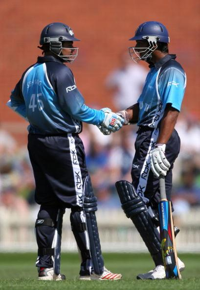 MELBOURNE, AUSTRALIA - OCTOBER 2:  Virender Sehwag of India and Kumar Sangakkara of Sri Lanka shake hands during the ICC World Xl v Victorian Bushrangers match at Junction Oval October 2, 2005 in Melbourne, Australia. (Photo by Quinn Rooney/Getty Images)