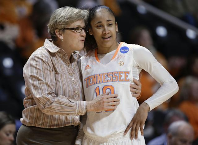 Tennessee head coach Holly Warlick talks with guard Meighan Simmons (10) in the second half of an NCAA women's college basketball first-round tournament game against Northwestern State, Saturday, March 22, 2014, in Knoxville, Tenn. Tennessee won 70-46. (AP Photo/Mark Humphrey)