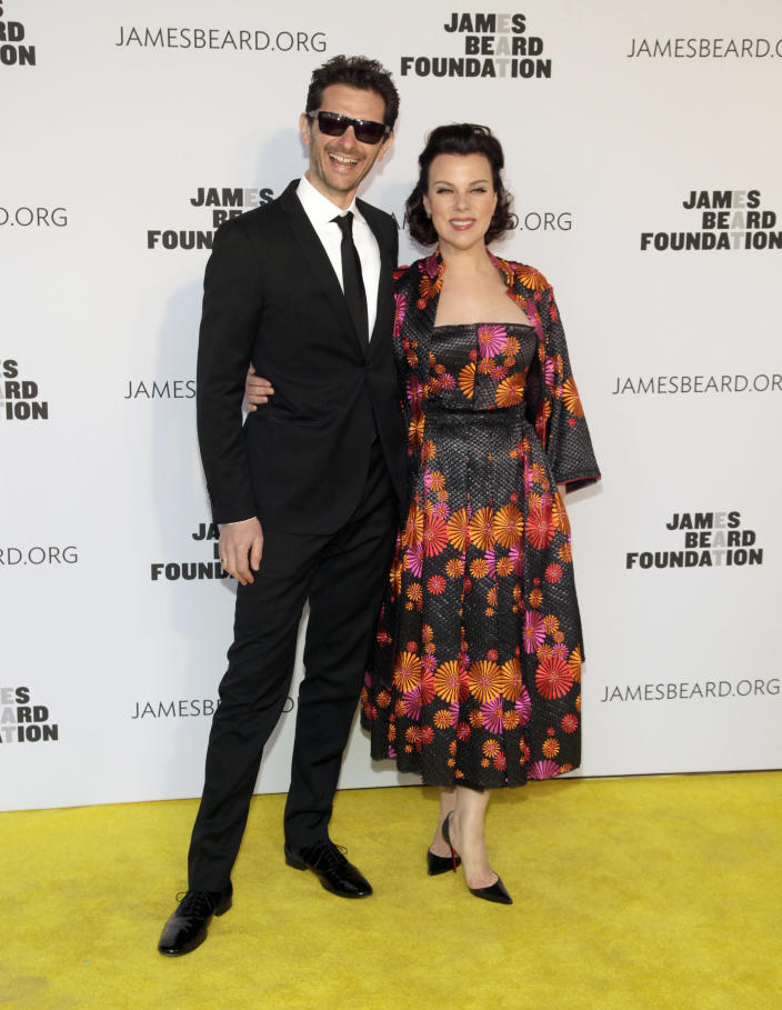 Television personality Gabriele Corcos, left, and his wife, actress Debi Mazar, right, attend the 2014 James Beard Foundation Awards on Monday, May 5, 2014, in New York. (Photo by Andy Kropa/Invision/AP)