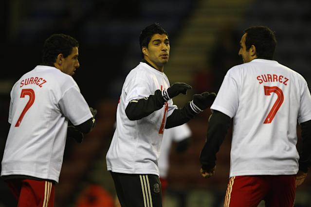 <p>Luis Suarez with two team-mates, all supporting the Uruguayan striker, after he is found guilty of racially abusing Patrice Evra and given an eight-match ban. </p>