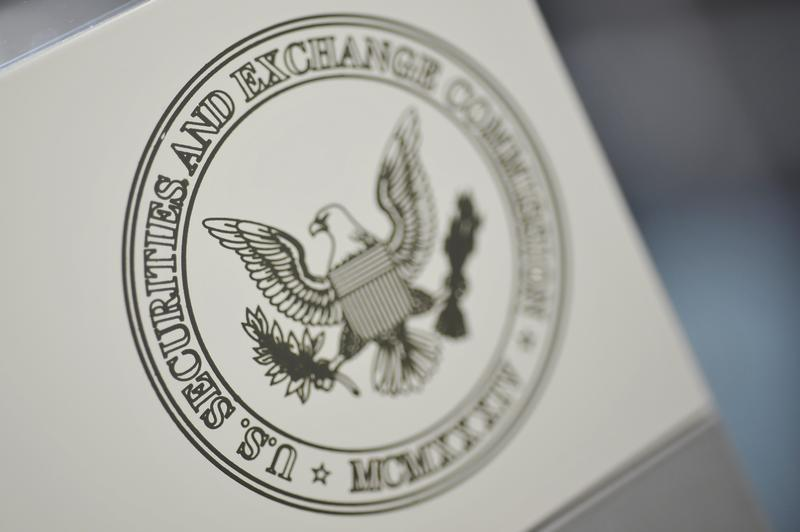 The U.S. Securities and Exchange Commission logo adorns an office door at the SEC headquarters in Washington, June 24, 2011