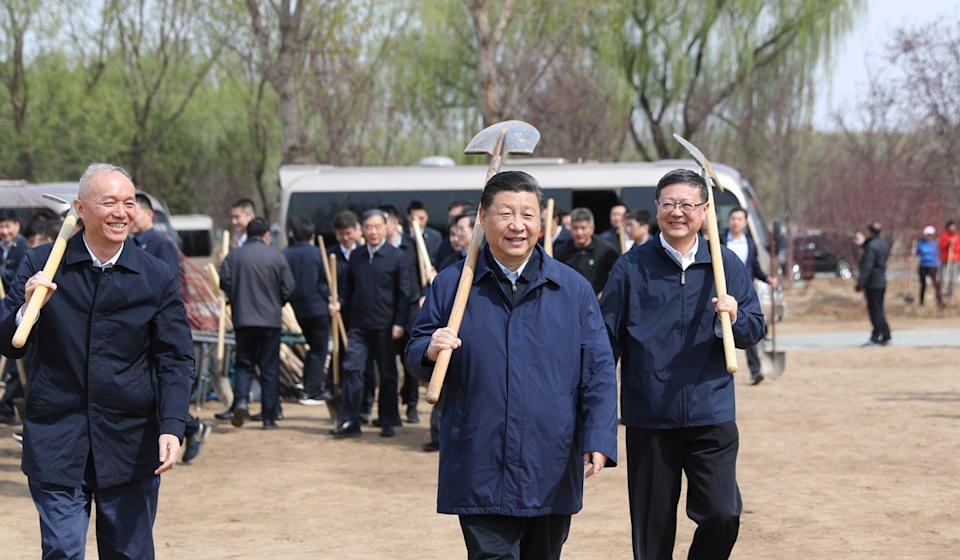 Xi Jinping pictured at a tree planting ceremony with other senior officials. (Xinhua/Ju Peng)