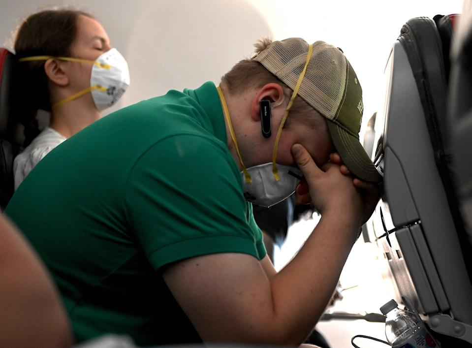 Though most passengers have respected American Airlines' mask policy, a pilot says some are removing theirs for more than eating or drinking. But absent a federal mandate requiring them, he says it's hard for flight crews to enforce the rule.
