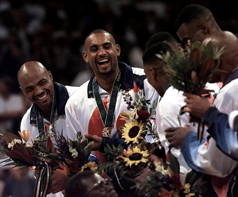 Charles Barkley, left, plans to sell the gold medal he won at the 1996 Olympics. (AP Photo/Hans Deryk)