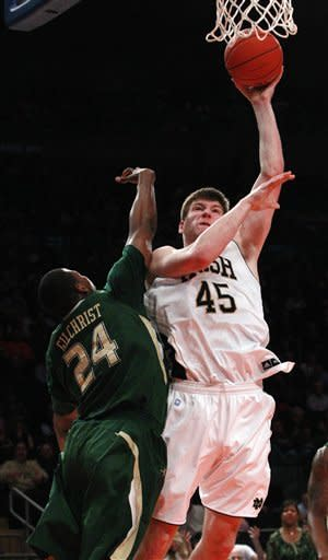Notre Dame's Jack Cooley (45) shoots over South Florida's Augustus Gilchrist (24) during the first half of an NCAA college basketball game in the quarterfinals of the Big East Conference tournament in New York, Thursday, March 8, 2012. (AP Photo/Frank Franklin II)