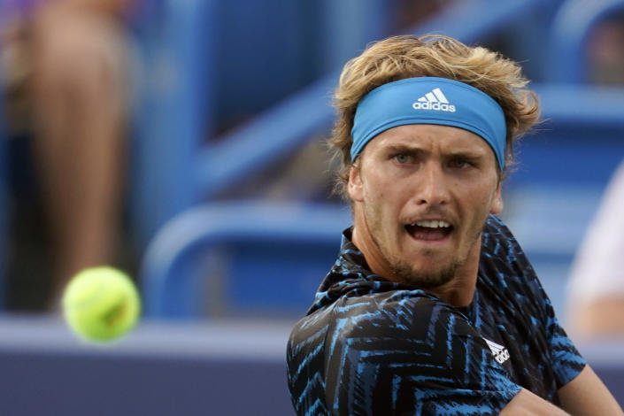 Alexander Zverev, of Germany, returns a shot to Andrey Rublev, of Russia, during the men's single final of the Western & Southern Open tennis tournament, Sunday, Aug. 22, 2021, in Mason, Ohio. (AP Photo/Darron Cummings)