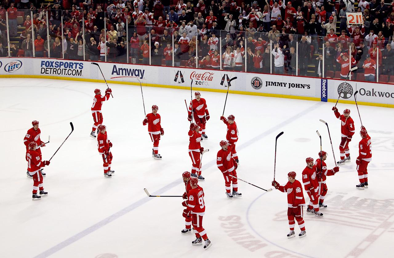 DETROIT, MI - FEBRUARY 14: The Detroit Red Wings salute their fans after their NHL record breaking 21st consecutive home victory by beating the Dallas Stars 3-1 at Joe Louis Arena on February 14, 2012 in Detroit, Michigan. (Photo by Gregory Shamus/Getty Images)
