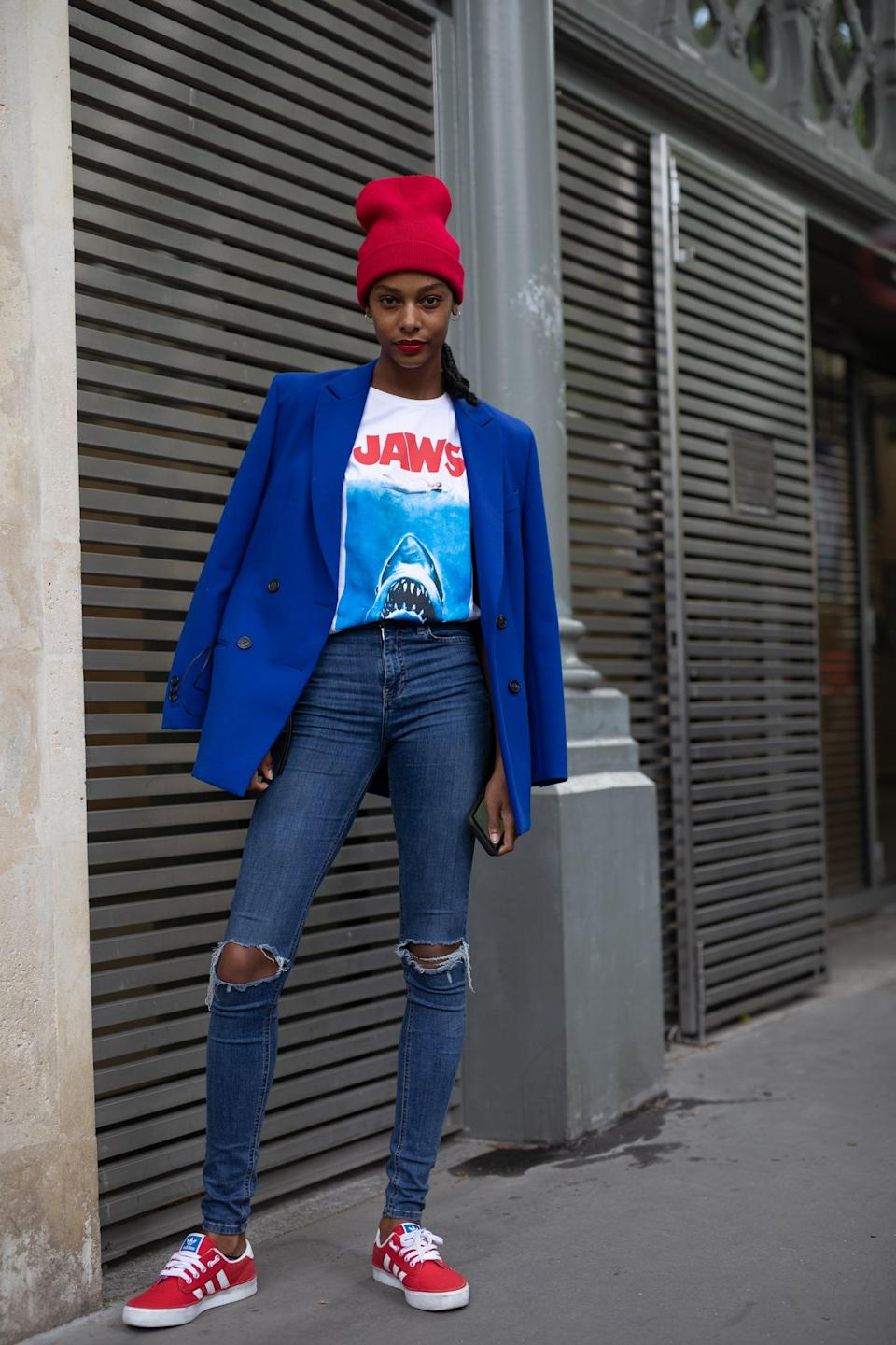 <p>In a bright color, like a bold red, a beanie can amp up a more basic everyday outfit. Add it to jeans and sneakers, then throw on a coat or blazer to finish it off. </p>