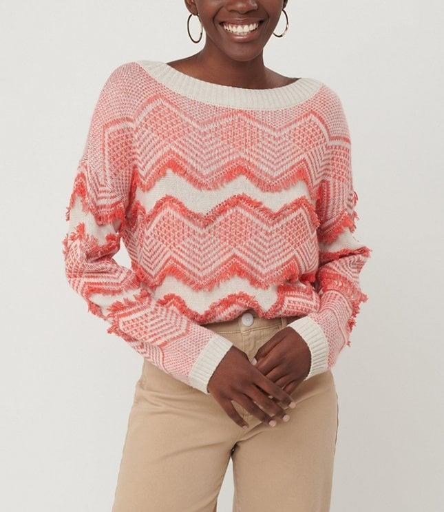 <p>This <span>Loft Zig Zag Fringe Sweater</span> ($70) is perfect for the holiday season.</p>