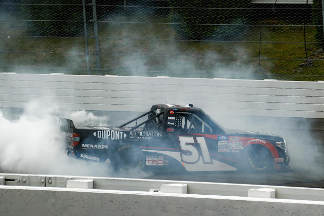 Brandon Jones smokes the tires in celebration after winning the NASCAR Truck Series auto race at Pocono Raceway, Sunday, June 28, 2020, in Long Pond, Pa. (AP Photo/Matt Slocum)