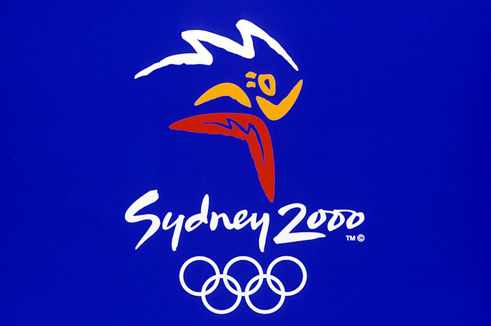 The logo for Sydney's 2000 Olympic Games is launched in Sydney, September 14, and features at its centre three Aboriginal boomerang shapes joined together in a stylised image of an athlete. Games organisers expect to earn A$100 million (US$80 million) in royalties over the next four years from domestic and international merchandising.  SPORT OLYMPIC LOGO
