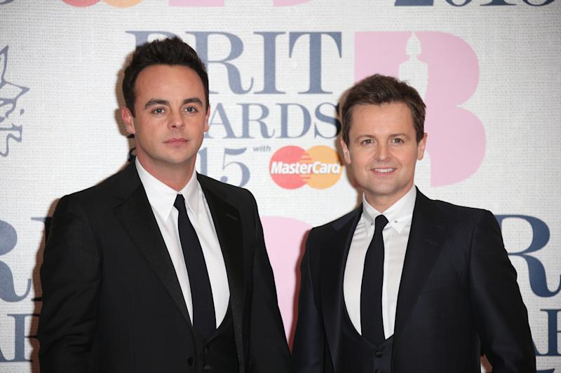 Anthony McPartlin and Declan Donnelly pose for photographers upon arrival at the Brit Awards 2015 at the 02 Arena in London, Wednesday, Feb. 25, 2015. (Photo by Joel Ryan/Invision/AP)