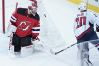 Washington Capitals center Lars Eller (20) skates against New Jersey Devils goaltender Mackenzie Blackwood (29) during the first period of an NHL hockey game, Saturday, Feb. 27, 2021, in Newark, N.J. (AP Photo/Mary Altaffer)