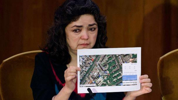 PHOTO: Witness Qelbinur Sidik holds up a photograph of the hospital where she says she underwent a forced sterilization procedure during hearings with lawyers and rights experts investigating abuses against Uyghurs in China, June 4, 2021, in London. (Tolga Akmen/AFP via Getty Images)