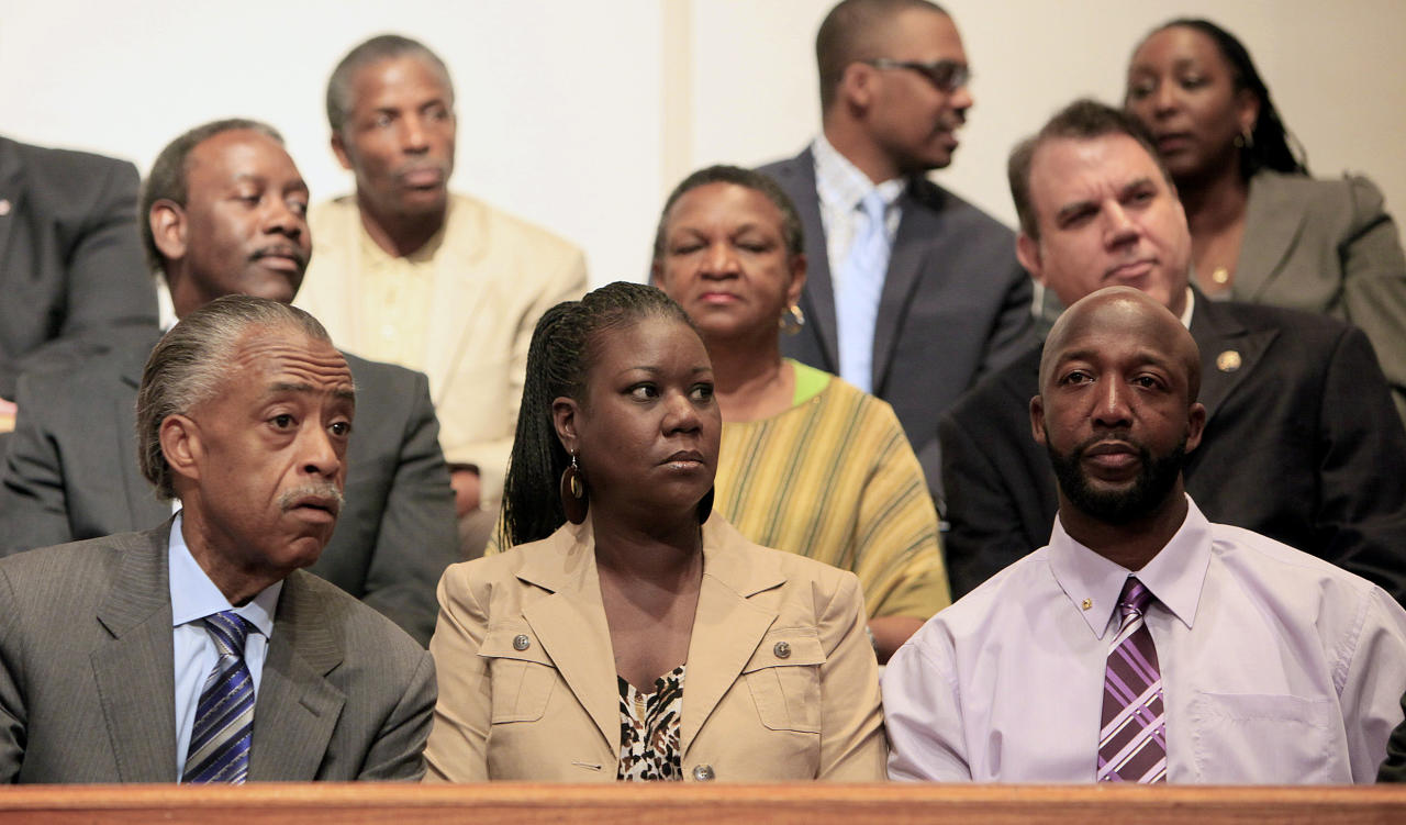 Rev. Al Sharpton, Sybrina Fulton and Tracy Martin, from left, listen during a community forum on slain Florida teenager Trayvon Martin at the Macedonia Baptist Church in Eatonville, Fla., Monday, March 26, 2012. Students also held rallies on the campus of Florida A&M University in Tallahassee and outside the Seminole County Criminal Justice Center, where prosecutors are reviewing the case to determine if charges should be filed. (AP Photo/Julie Fletcher)
