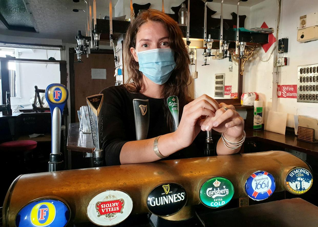 **EMBARGOED UNTIL 2PM BST / JULY 1, 2021**  Publican Jemima Burke at the bar of the Castle Inn, Dover.  A brazen thief caught on camera stealing £5,000 worth of gear in Dover couldn't be nicked because he had left England by going through customs and was waiting for a ferry to France.  See SWNS story SWNNburglar.  The Italian committed the 'perfect crime' by raiding a pub and driving into a Channel ferry port - a few hundred yards away.  Once there, he couldn't be arrested - by Dover cops or the gendarme - despite being pointed out by the enraged victim.  He was deemed to be on French soil - while the burglary had been committed on British soil.  The bearded suspect, a 31 year old called Luca is understood to have arrived safely home in Italy.  Publican Jemima Burne, 29, was tipped off about the daylight raid by builders working at the Castle Inn.  He timed it to coincide with his hasty departure. He calmly strolled into the bar helping himself to a rare guitar, an amp and a variety of other goods.  He was caught on CCTV around 1pm on June 9 loading his swag into a dark blue Peugeot - and made off. But furious Jemima tracked him down - into the nearby terminal.