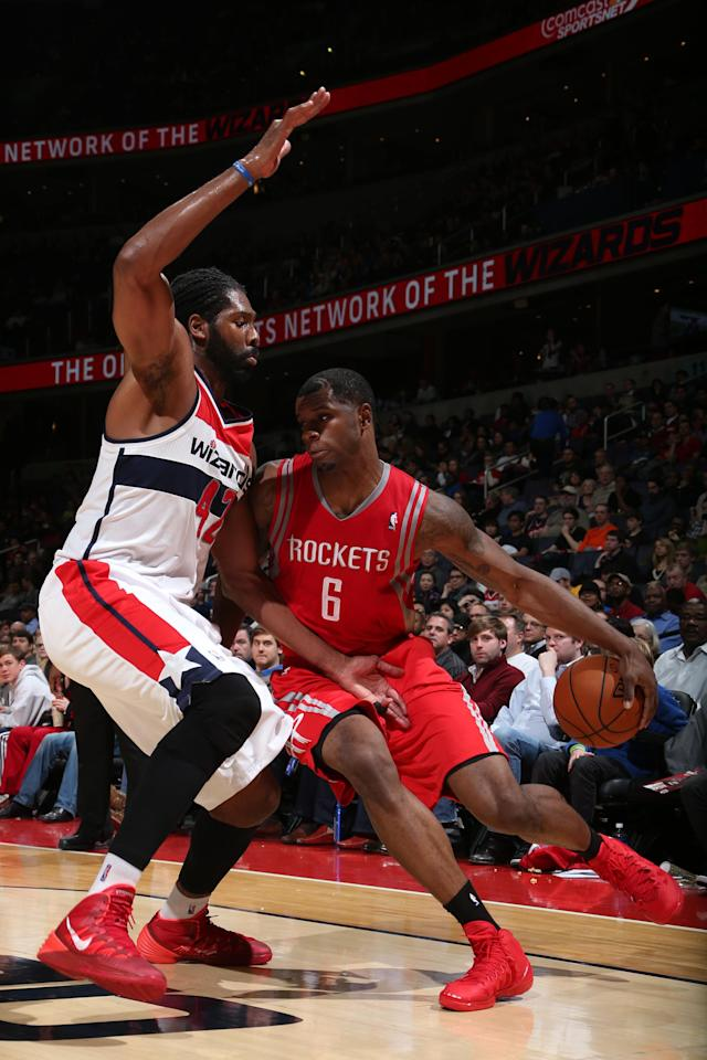 WASHINGTON, DC - JANUARY 11: Terrence Jones #6 of the Houston Rockets drives against Nene #42 of the Washington Wizards during the game at the Verizon Center on January 11, 2014 in Washington, DC. (Photo by Ned Dishman/NBAE via Getty Images)