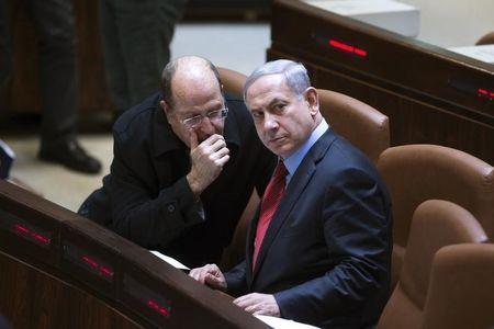 Israel's Defence Minister Yaalon speaks with Prime Minister Netanyahu during a session of the Knesset, the Israeli parliament, in Jerusalem