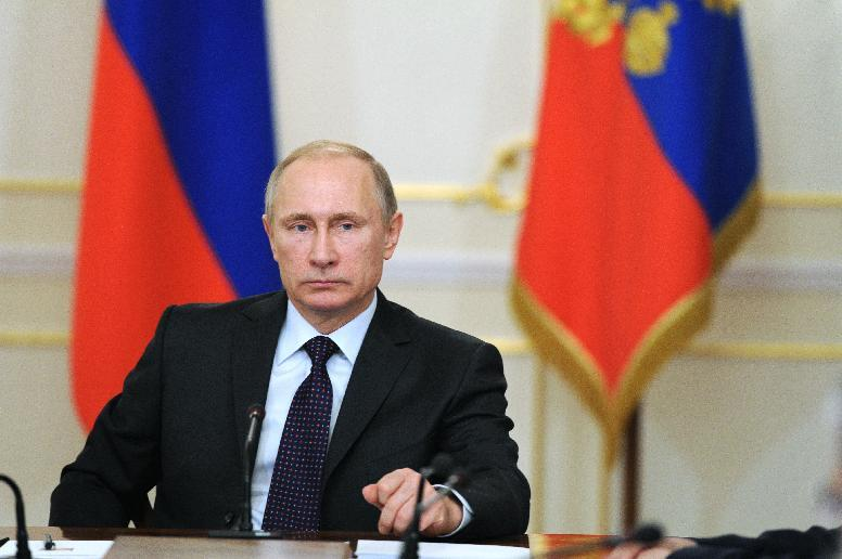 Russian President Vladimir Putin chairs a meeting at the Novo-Ogaryovo residence, outside Moscow, on February 4, 2015