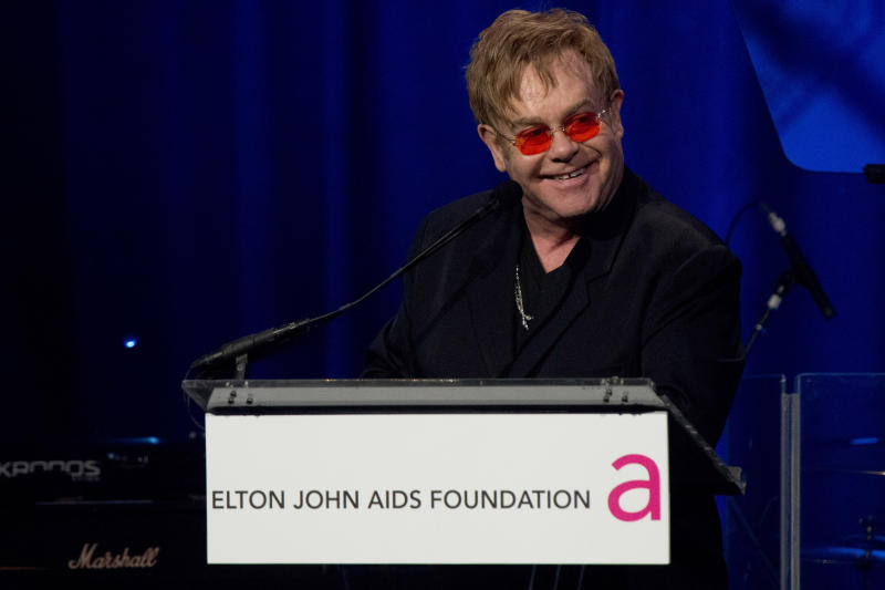 FILE - In this Monday, Oct. 15, 2012 file photo, Elton John appears on stage at his AIDS Foundation's 11th annual Enduring Vision benefit, in New York. John is one of the world's leading celebrity contributor's to charity. (Photo by Charles Sykes/Invision/AP, File)
