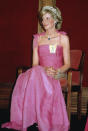 While at a state reception in Australia, Princess Diana stole the headlines in a fuchsia gown by Victor Edelstein. The mother-of-two's famous Spencer tiara, which she wore on her wedding day in 1991, gave the ensemble a regal touch. <em>[Photo: Getty]</em>