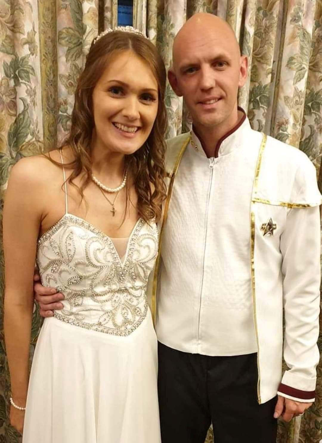 Viktorija, originally from Latvia, and Chris, pictured on their wedding day, discussed the idea of marriage on their first date. [Photo: SWNS]
