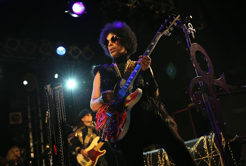"""This photo taken on Tuesday Feb. 5, 2014 and released by 3RDEYEGIRL NPG Records on Wednesday Feb. 5, 2014, shows Prince performing in London. The enigmatic star flew into London on Tuesday at the start of a still-evolving string of dates in support of forthcoming album """"Plectrum Electrum,"""" recorded with all-female trio 3RDEYEGIRL. Details are being released in a trickle, but Prince said he planned to play """"iconic"""" venues along the lines of music club the Bag o' Nails — where Jimi Hendrix once played — storied rock venue Electric Ballroom and Ronnie Scott's jazz club. """"We'll work our way up, if people like us, to bigger venues,"""" Prince said. (AP Photo/3RDEYEGIRL NPG Records)"""
