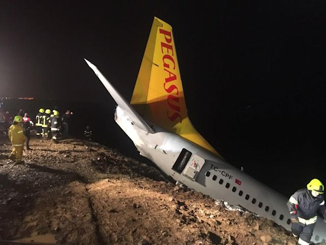 <p>A Pegasus airplane carrying 162 passengers is seen stuck in mud as it skidded off the runway after landing in Trabzon Airport, Turkey early Sunday on Jan. 14, 2018.(Photo: Tugba Yardimci/Anadolu Agency/Getty Images) </p>