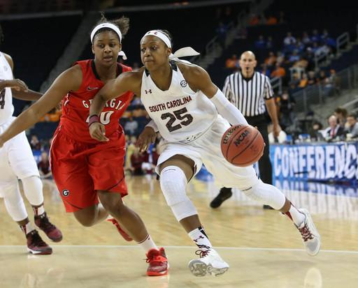 South Carolina guard Tiffany Mitchell (25) drives against Georgia forward Shacobia Barbee (20) in the first half of a quarterfinal NCAA college basketball game in the women's Southeastern Conference, Friday, March 7, 2014, in Duluth, Ga. South Carolina defeated Georgia 67-48. (AP Photo/Jason Getz)