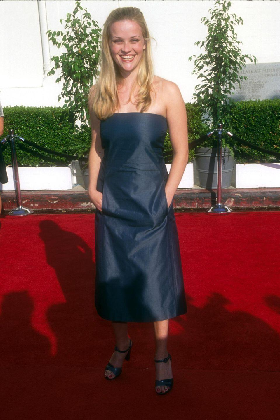 <p>Reese rocked not one, but two early 2000s trends at the Blockbuster Entertainment Awards (oof that's a throwback in itself): a strapless midi dress made out of a heavy crepe fabric.<br></p>