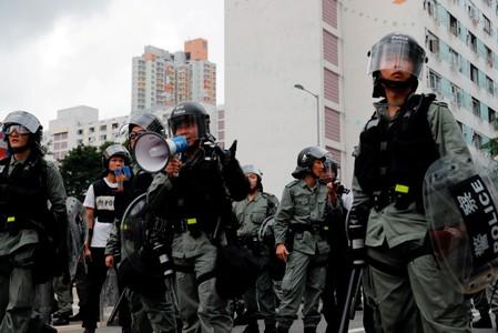 FILE PHOTO: Riot police ask anti-extradition bill protesters to leave in front of public housing after a march at Sha Tin District of East New Territories, Hong Kong