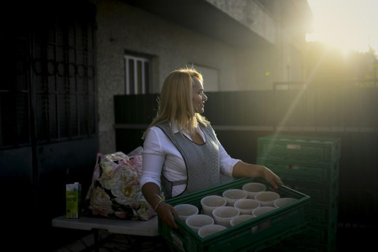 "Volunteer for the ""Amigos de Rua"" charity, Brazilian Luciene Santos, 43, prepares food for the homeless at her house in Quinta do Conde"