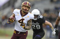 Minnesota running back Shannon Brooks (4) rushes for a touchdown during the first half of an NCAA football game against Northwestern, Saturday, Nov. 23, 2019, in Evanston, Ill. (AP Photo/Paul Beaty)
