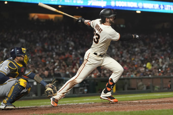 San Francisco Giants' Kris Bryant watches his RBI double in front of Milwaukee Brewers catcher Omar Narvaez during the fifth inning of a baseball game in San Francisco, Wednesday, Sept. 1, 2021. (AP Photo/Jeff Chiu)