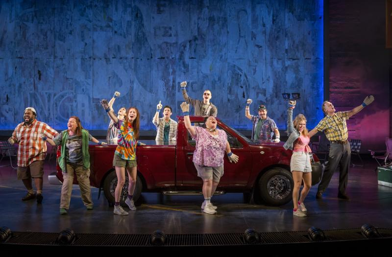 "FILE - This file theater image released by The Hartman Group shows the cast during a performance of ""Hands on a Hard Body,""  at the Brooks Atkinson Theater in New York and featuring songs co-written by Phish frontman Trey Anastasio.  (AP Photo/The Hartman Group, Chad Batka, File)"