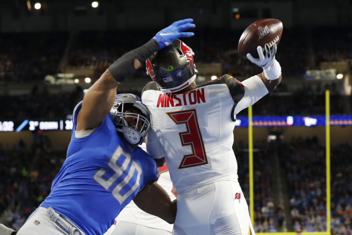 FILE - Tampa Bay Buccaneers quarterback Jameis Winston (3) throws before being hit by Detroit Lions defensive end Trey Flowers (90) during the first half of an NFL football game, Sunday, Dec. 15, 2019, in Detroit. NFL teams can always use more pass rushers, as evidenced by the NFC North where all four teams have spent big to acquire them over the last three years. (AP Photo/Paul Sancya, FIle)