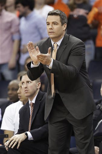 Virginia coach Tony Bennett cheers on his team during the first half of an NCAA college basketball game against Virginia Tech on Tuesday, Feb. 12, 2013, in Charlottesville, Va. (AP Photo/Steve Helber)