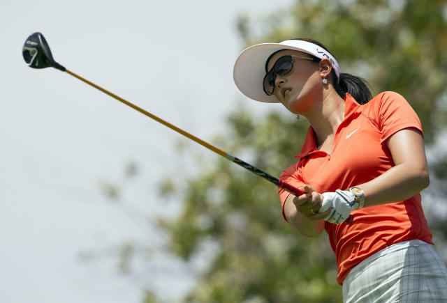 Michelle Wie watches her drive off the second tee in the final round of the LPGA LOTTE Championship golf tournament at Ko Olina Golf Club, Saturday, April 19, 2014, in Kapolei, Hawaii. (AP Photo/Eugene Tanner)