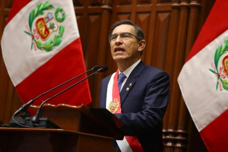 "In this handout picture released by Andina, Peruvian President Martin Vizcarra addresses the congress in Lima, Peru, on July 28, 2019. Vizcarra proposed early elections to end ""institutional crisis"""