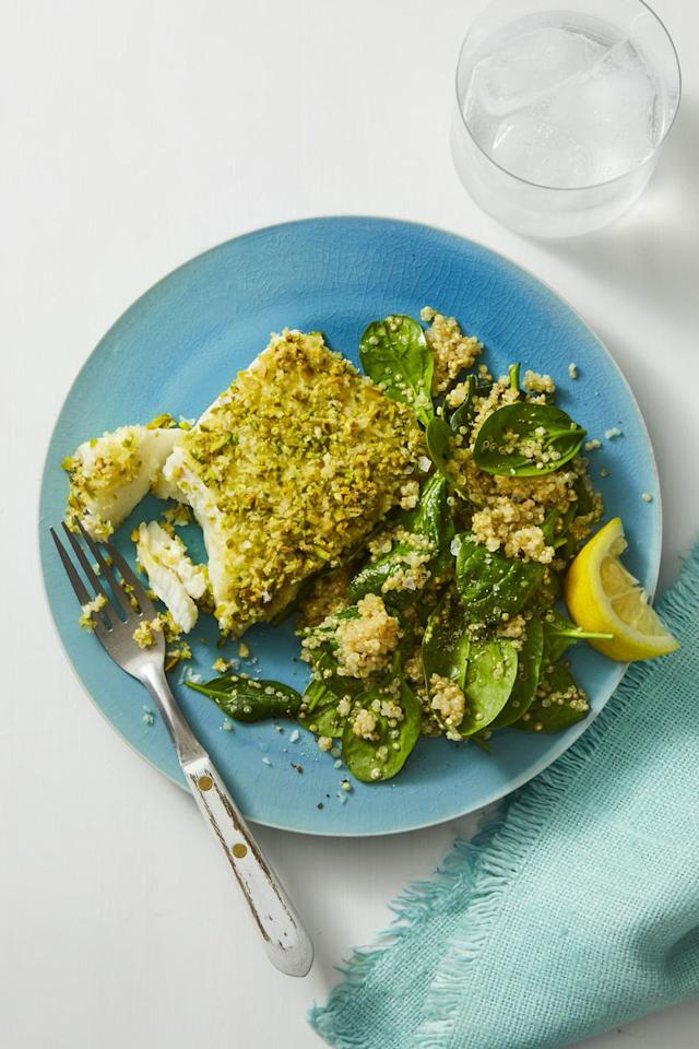 """<p>This flavorful dinner is packed with good-for-you ingredients like quinoa, fish, Greek yogurt, and spinach.</p><p><strong><a rel=""""nofollow"""" href=""""https://www.womansday.com/food-recipes/food-drinks/a19758207/pistachio-crusted-fish-recipe/"""">Get the recipe.</a></strong></p>"""