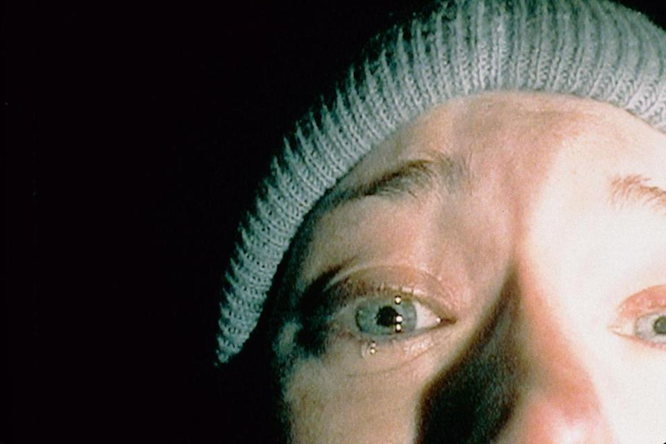 """<p><strong><em>The Blair Witch Project</em></strong> </p><p>Three young filmmakers get lost in haunted woods as they videotape their terrifying final moments. The independent film was a breakout hit grossing nearly $250 million — becoming an instant pop culture phenomenon upon its release.</p><p><a class=""""link rapid-noclick-resp"""" href=""""https://www.amazon.com/Blair-Witch-Project-Heather-Donahue/dp/B000KDZSA4/?tag=syn-yahoo-20&ascsubtag=%5Bartid%7C10055.g.29120903%5Bsrc%7Cyahoo-us"""" rel=""""nofollow noopener"""" target=""""_blank"""" data-ylk=""""slk:WATCH NOW"""">WATCH NOW</a></p>"""
