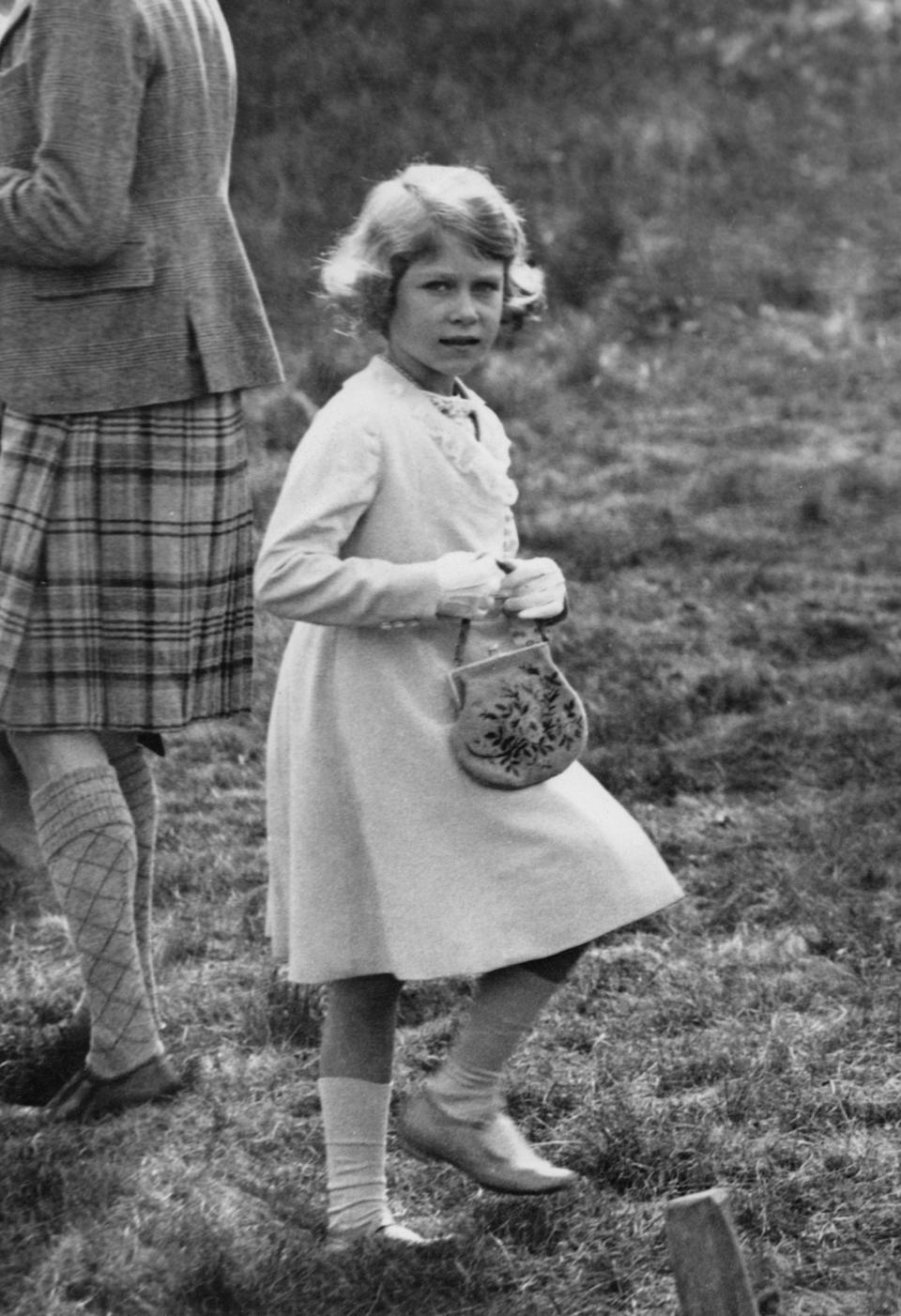 Many people have suggested that the young king looks exactly like the queen (pictured in 1933 at the age of seven) (Getty Images)