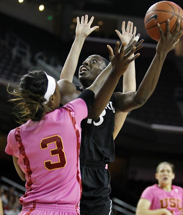 Stanford forward Chiney Ogwumike, right, shoots the ball against Southern California forward Desiree Bradley (3) during the first half of an NCAA college basketball game Friday, Feb. 21, 2014, in Los Angeles. (AP Photo/Alex Gallardo)